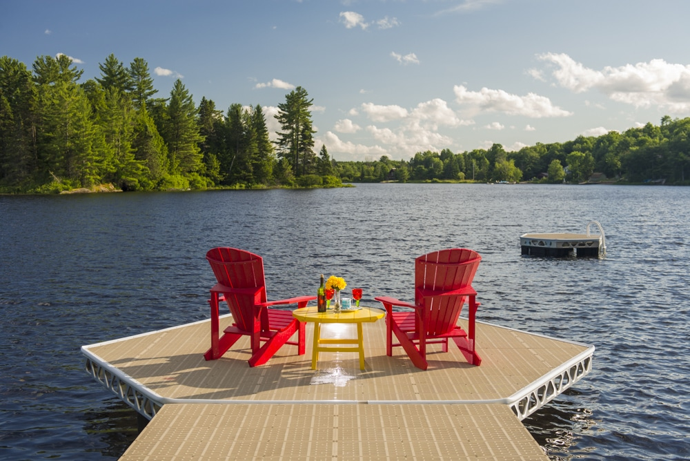 ThruFlow dock with floating island and muskoka chairs