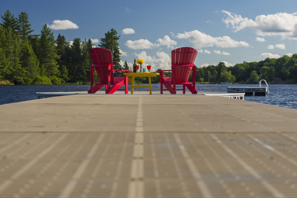 CanadaDocks dock and floating island with Muskoka Chairs