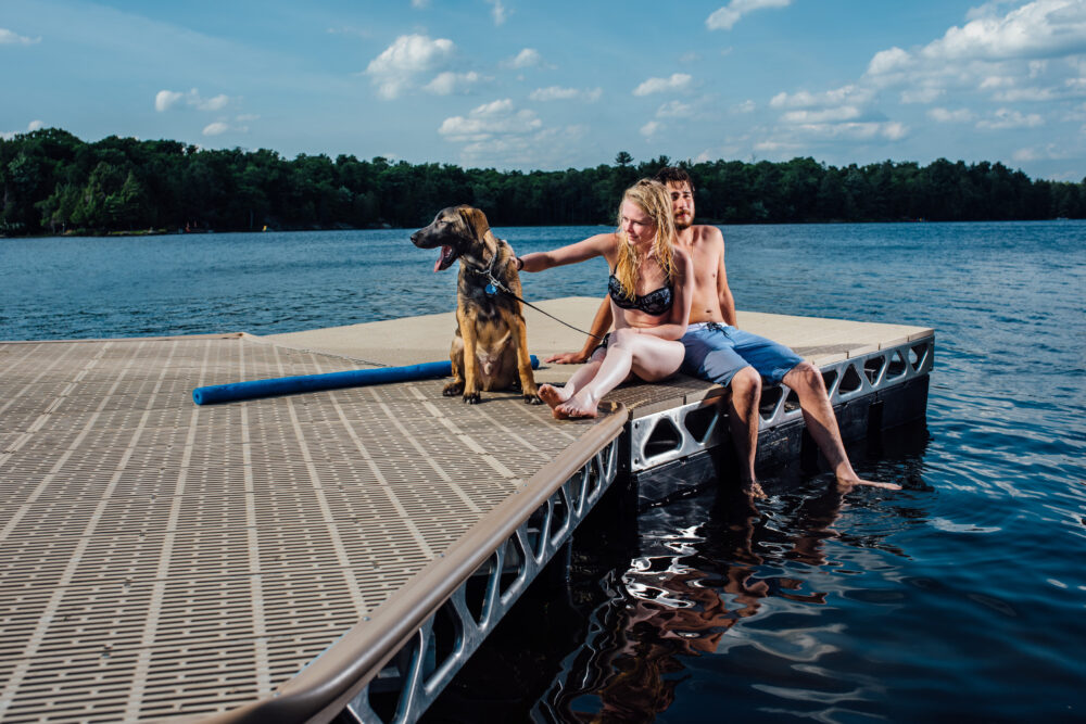 Couple and dog on an 8x8 floating CanadaDocks dock