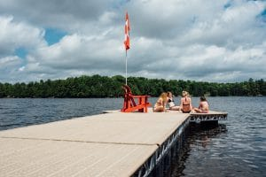 Group of girls sitting on a CanadaDocks floating 8x8 Hexagon dock