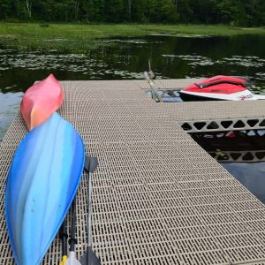 Canoe and Kayak storage on a CanadaDocks standing dock with 1500lb boat lift