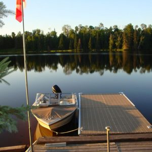 CanadaDocks dock with bumpers and boat at sunrise