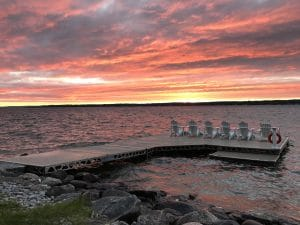 Lake Simcoe Sunset on a CanadaDocks dock with muskoka chairs