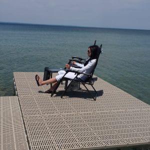 Woman relaxing on CanadDocks dock