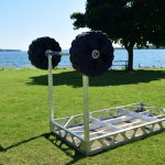 CanadaDocks standing dock wheel kit being installed on an upside down dock