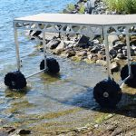 CanadaDocks standing dock wheel kit rolling into the lake