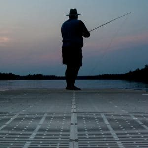 Fly fishing off the edge of a CanadaDocks dock