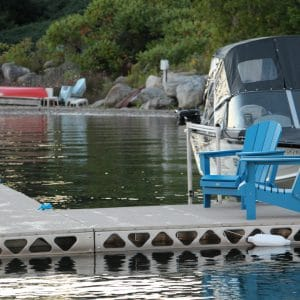 Canada docks standing dock with ladder, boat lift and muskoka chairs