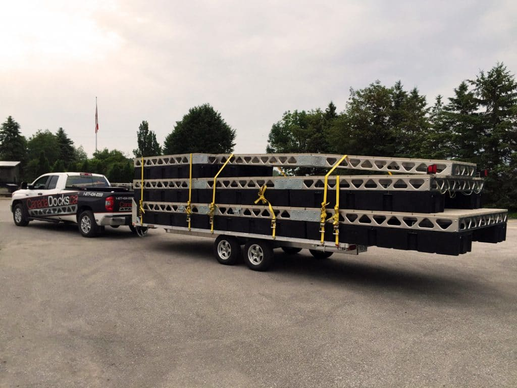 Flat Bed Trailer Loaded with Floating Dock Sections