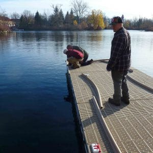 Installing Bumpers of CanadaDocks Floating Dock