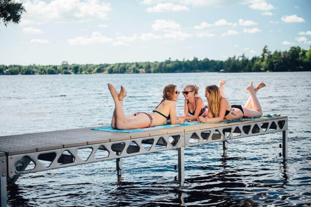 Girls Sunbating on a CanadaDocks Standing Dock
