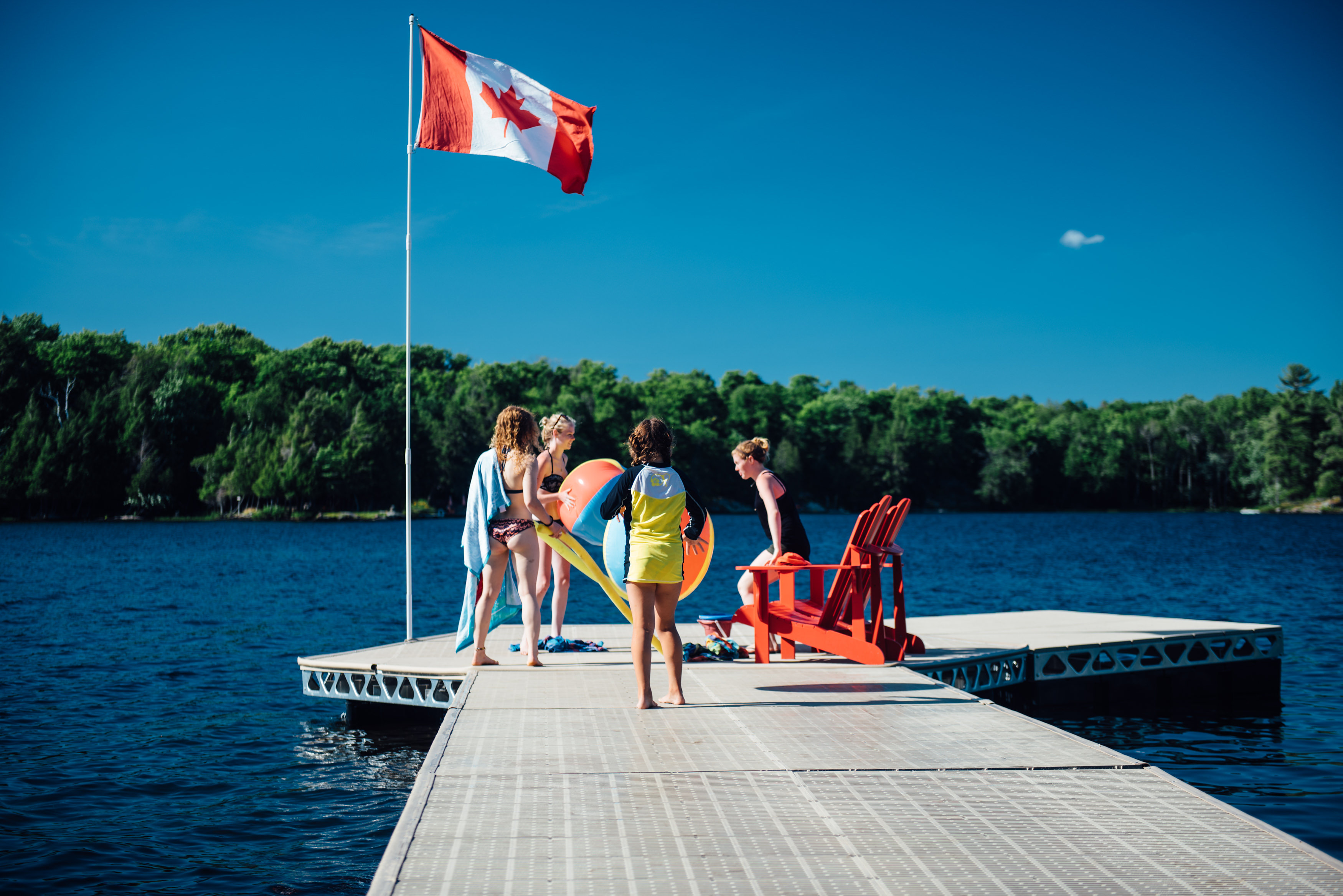 Playing on the dock with beach balls