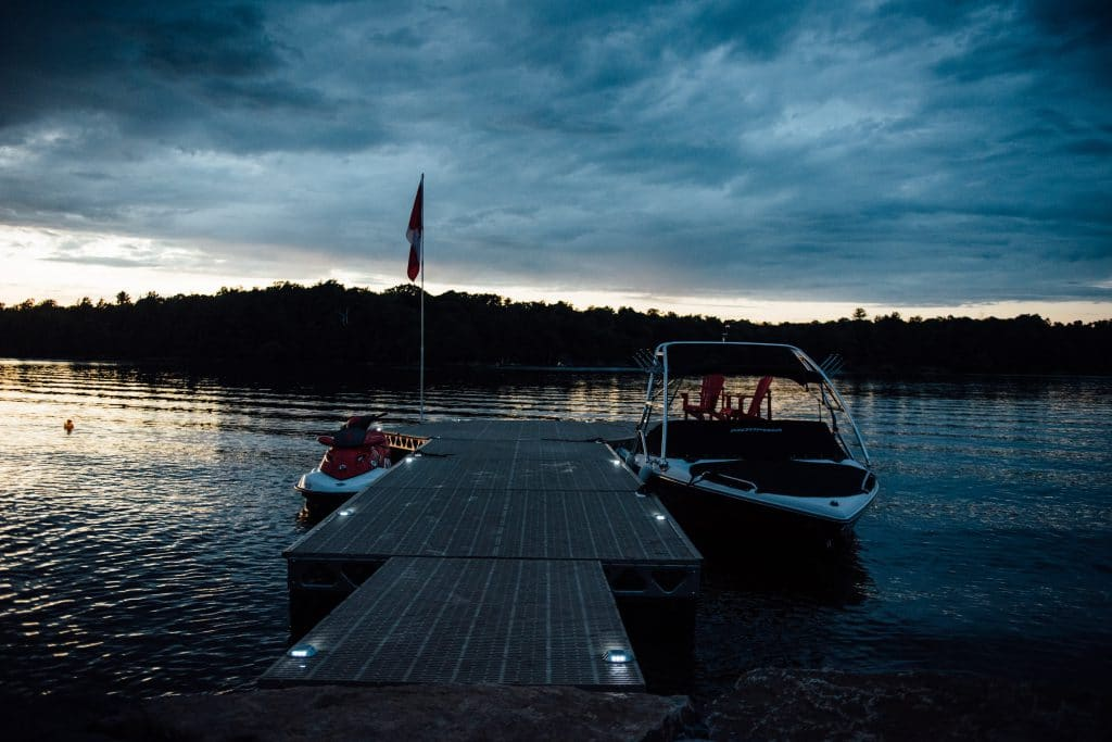 White Solar LED lights on a CanadaDocks dock with Boat and JetSki