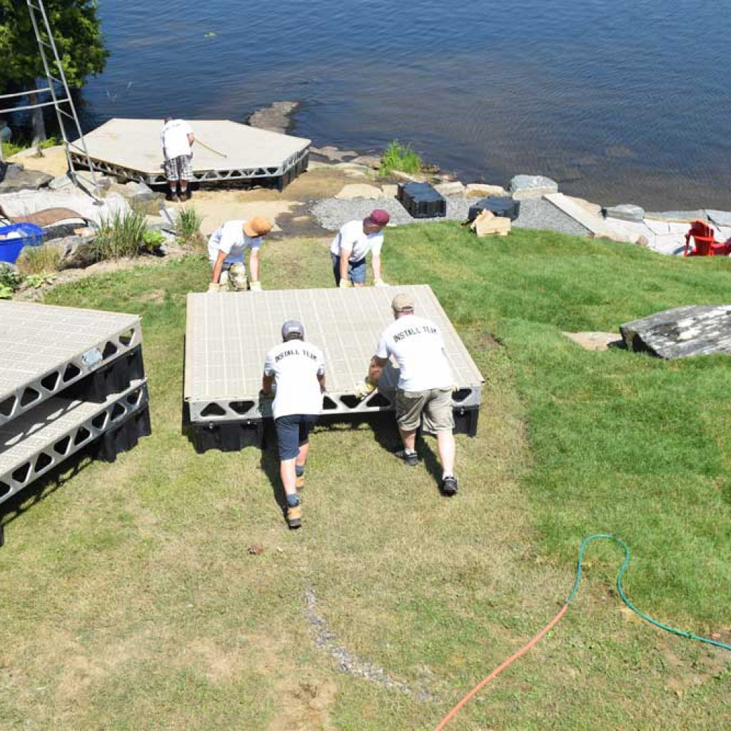 Team Pushing an 8x8 floating dock section to shore