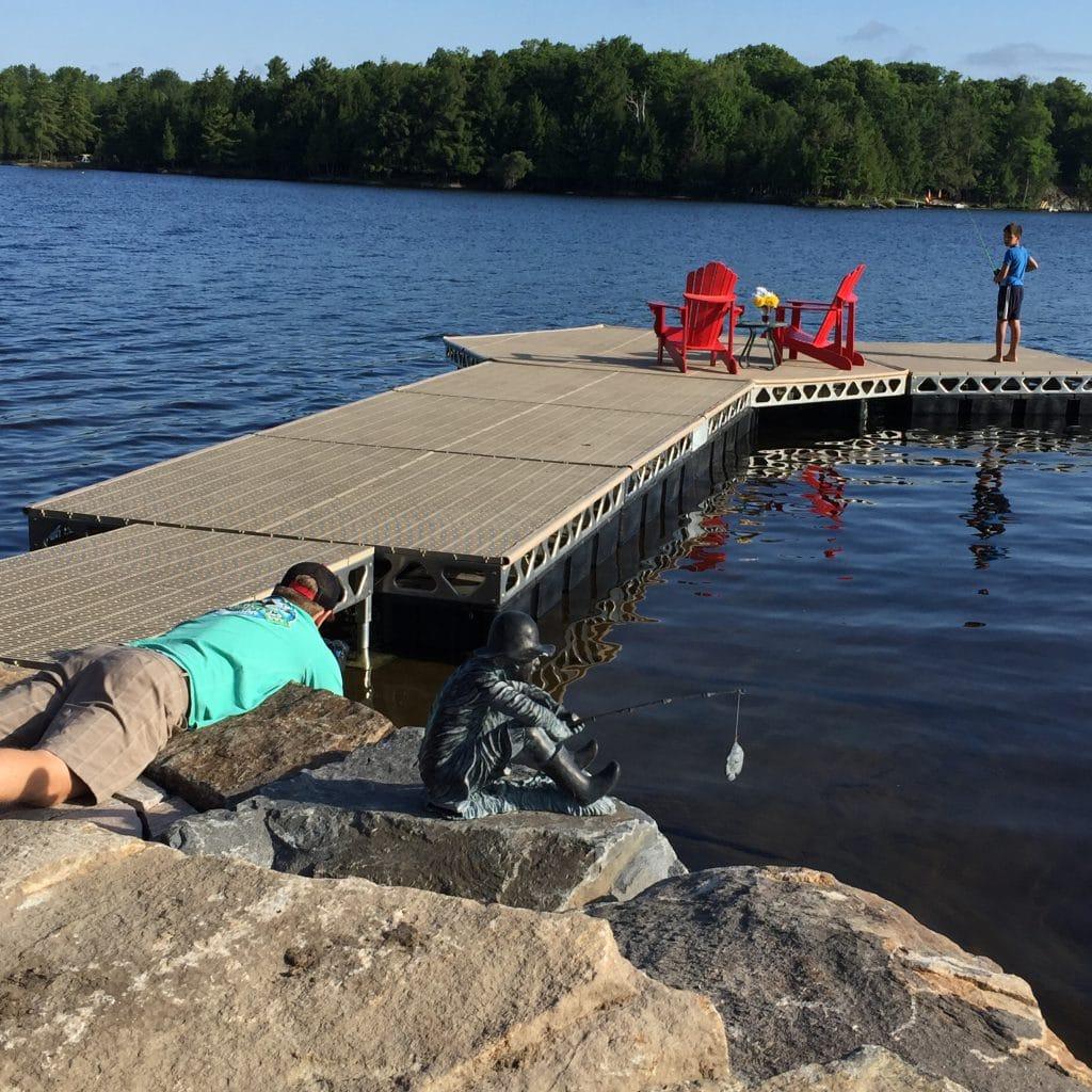 Kid fishing off a CanadaDocks floating hexagon dock