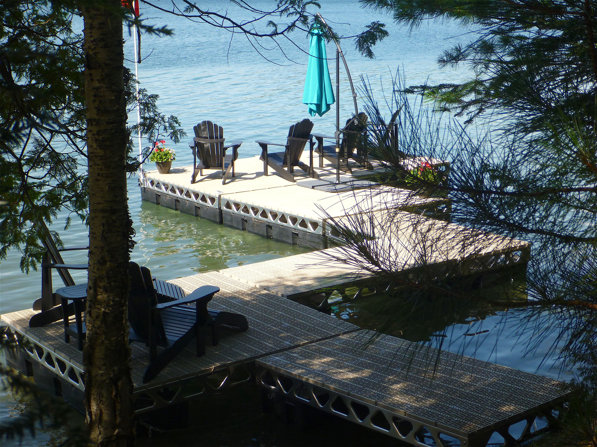 CanadaDocks Customer Dock with ThruFlow decking and Muskoka chairs