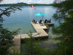 CanadaDocks Customer Dock with ThruFlow decking and Muskoka chairs