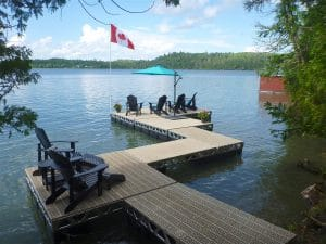 A CanadaDocks floating dock with ramp and Thruflow Decking