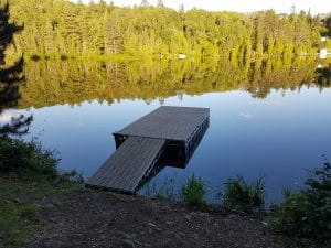 CanadaDocks floating dock on a mirror reflective lake