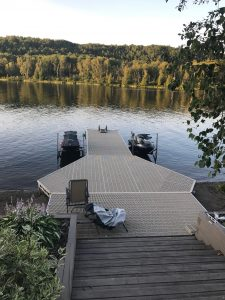 CanadaDocks custom dock with boatlifts and folding ladder
